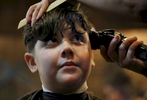 James Kaplan, 9, gets a haircut from Bobby Jean Larrañaga, Feb. 17, 2017 at The Shop in Berkeley, Calif., almost exactly a year after the same hair stylist cut his hair into a {quote}boy style{quote} when he came out as a transgender boy.