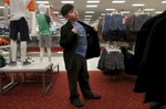 James Kaplan, 9, puts on a cool guy persona while trying on a new blazer during a shopping trip to Target for new clothes Feb. 17, 2017 in Berkeley, Calif. James vividly remembers the first time he went shopping with his mother in the boy's section of the store, it was an experience he had only dreamed about before he came out.
