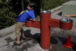James Kaplan, 8, drenches his shirt in a water fountain while playing after school Sept. 7, 2016 in Berkeley, Calif.