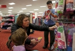 Sara Kaplan, center, picks out her first set of girl panties for Olivia Kaplan, 4, left,  as James, 9, examines a bra during a trip to Target to find formal clothes for James Feb. 17, 2017 in Berkeley, Calif. Olivia, James' sibling, had been describing herself as trans for much of the past year since her brother came out as a transgender boy. Sara and Ben decided to brush it off to see if it was just something she was saying to copy her sibling. But it became apparent over time that it was very real to Olivia. She has always been a feminine child and she finally shouted at her parents that she was a girl at the beginning of the year. They cautiously allowed her to begin the transition. As of June, 2017, Olivia is still happily presenting as a girl. Sara and Ben plan on doing what they have for James: provide a supportive space for their children to be themselves whoever they turn out to be later in life.