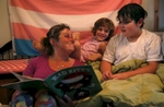Sara Kaplan reads a bedtime story to her children Olivia, 5, center, and James, 9, in Berkeley, Calif. Olivia, James' sibling, had been describing herself as trans for much of the past year since her brother came out as a transgender boy. Sara and Ben decided to brush it off to see if it was just something she was saying to copy her sibling. But it became apparent over time that it was very real to Olivia. She has always been a feminine child and she finally shouted at her parents that she was a girl at the beginning of the year. They cautiously allowed her to begin the transition. As of June, 2017, Olivia is still happily presenting as a girl. Sara and Ben plan on doing what they have for James: provide a supportive space for their children to be themselves whoever they turn out to be later in life.