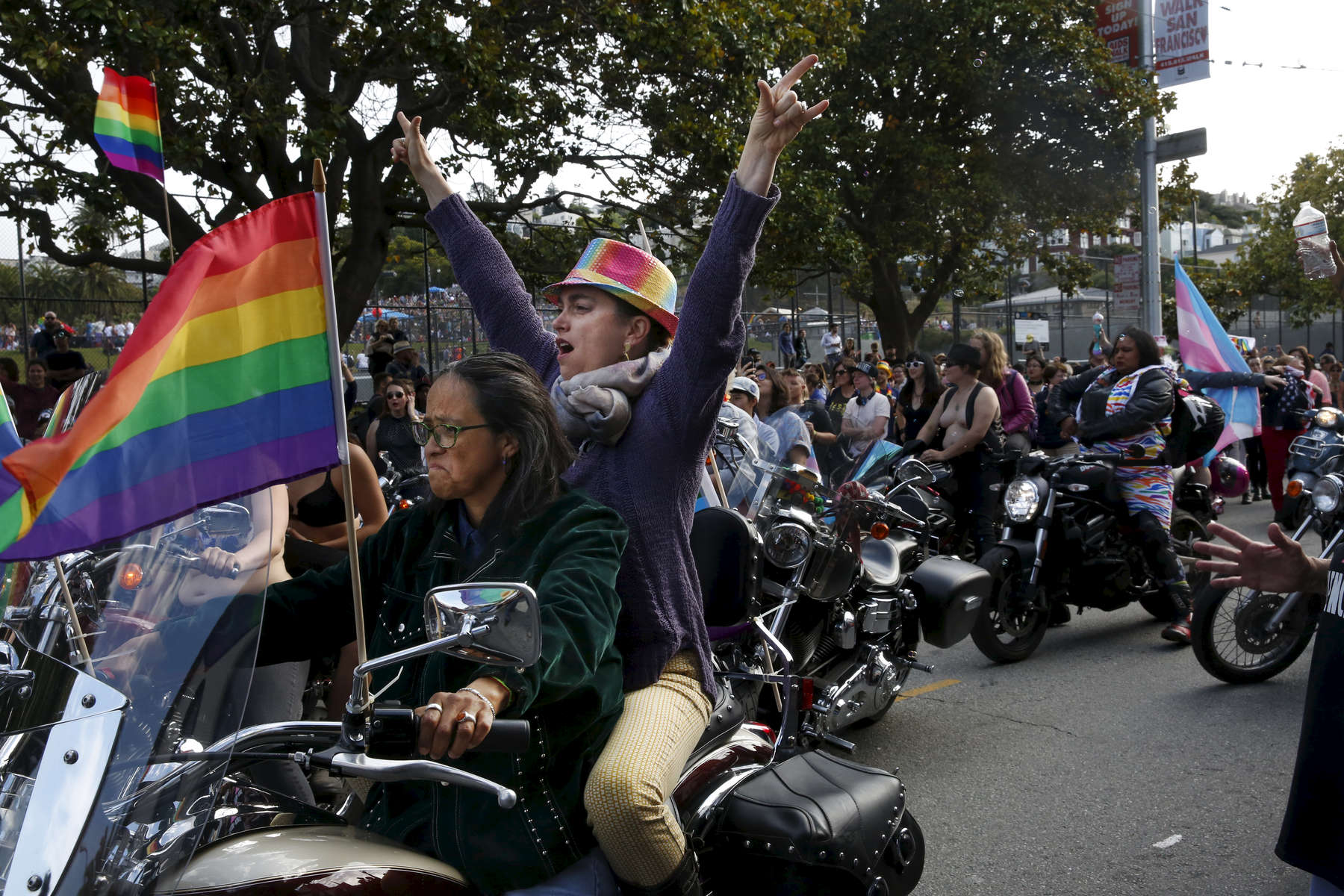 Chagua Camacho, left, revs her engine as Tracy Burt cheers right before they start the parade with the rest of the Dykes on Bikes during the annual Dyke March that started at Mission Dolores park and snaked around the neighborhood up through the Castro and back June 24, 2017 in San Francisco, Calif.