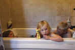 "From left, Markegard siblings Quill, 6, Quince, 4, and Larry, 7, take their weekly bath together to save water in their family home Nov. 4, 2014 in Half Moon Bay, Calif. The Markegards started their grass-fed business nine years ago on 1,000 acres of land they've leased for years in Half Moon Bay. As the drought worsened this year, they saw their 16 water sources shrink to just one. They've had to move their 4-500 head of cattle to land leased off the property because all of the water sources on their land have dried up, including the spring that used to provide water for their home. Now they have to haul in water for their family once about every three weeks. ""We watch every drop,"" said Doniga about their water conservation."