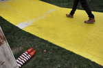 A man walks across a short brick pathway that was later painted yellow and a small Wizard of Oz house was also later added on the Facebook campus Nov. 12, 2014 in Menlo Park, Calif.