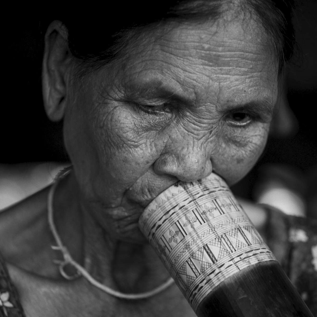 laos-south-ethnic-minority-lao-katu-bamboo-pipe-tiger-trail-photo-by-cyril-eberle--CEB_4594