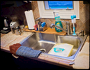 This is what makes me feel just like every other parent out there. Doing dishes at 4a.