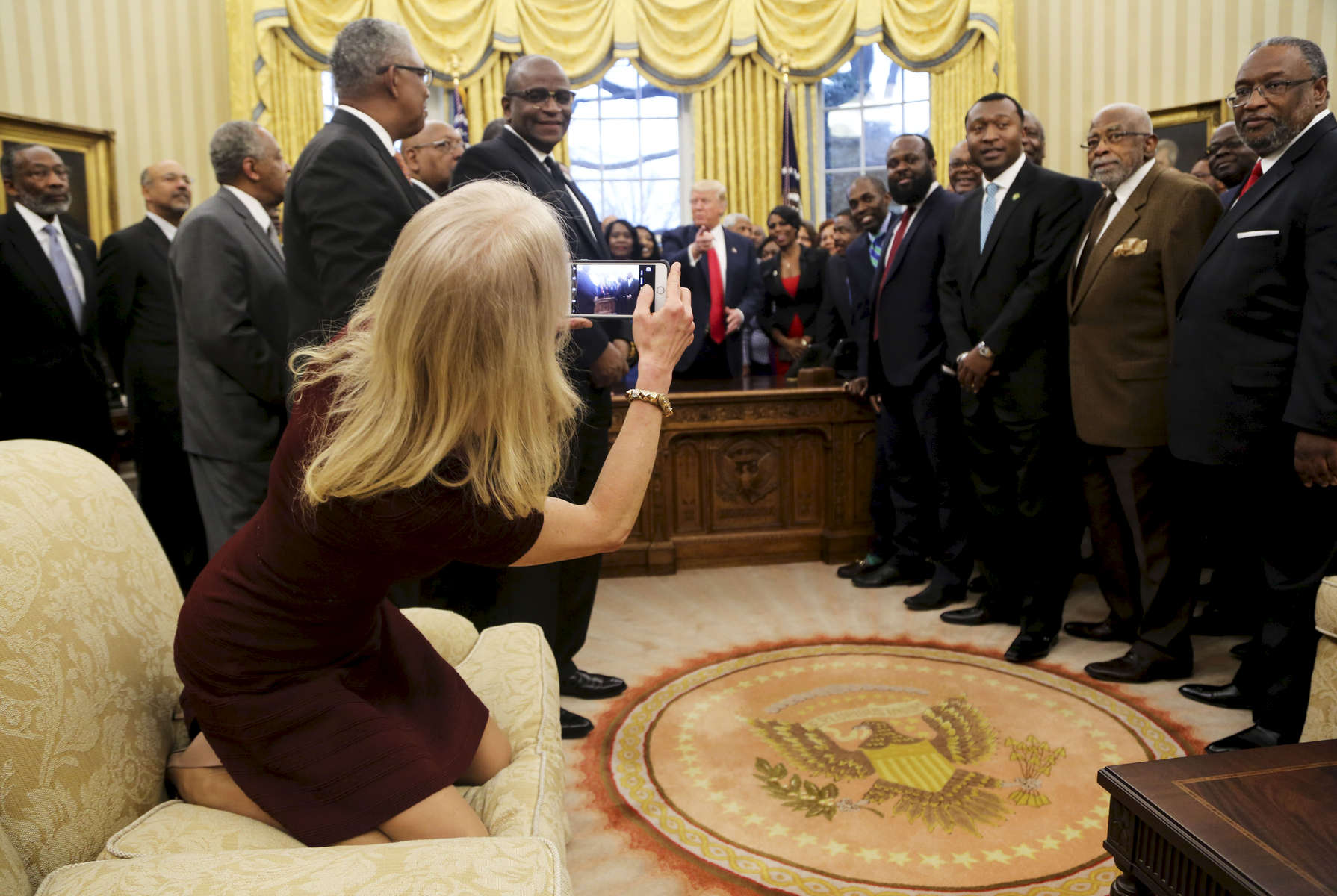 Counselor to the President Kellyanne Conway takes a picture of U.S. President Donald Trump with members of the Historically Black Colleges and Universities in the Oval Office of the White House.