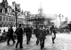 A group of militaries walk in front of the Hotel de Ville, the mayor of Paris' office, on December 21, 2015, Paris, France. 3000 of additional militaries were deployed in Paris after the terrorist attacks of November 13.