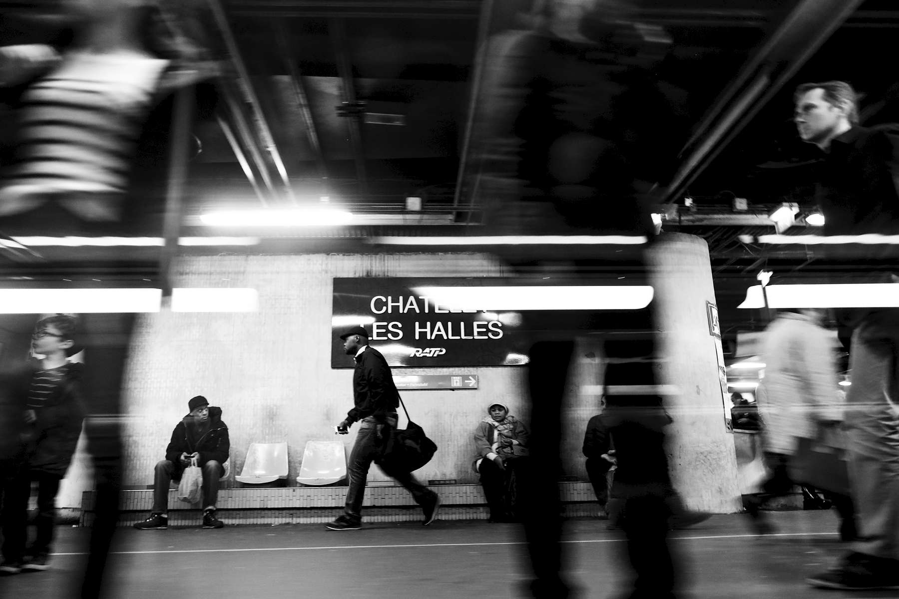 People were for the RER, an express train line that deserves Paris and its suburbs, at the central and always  busy station, Chatelet - les Halles, on December 24, 2015, Paris, France. A bomb exploded in 1986 in the large mall build around this train station, 22 people were injured but nobody was killed in this attack, attributed to the Hezbollah.