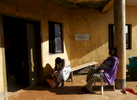 Pregnant women wait outside of the medical facility of Kuchigoro in Abuja, Nigeria.