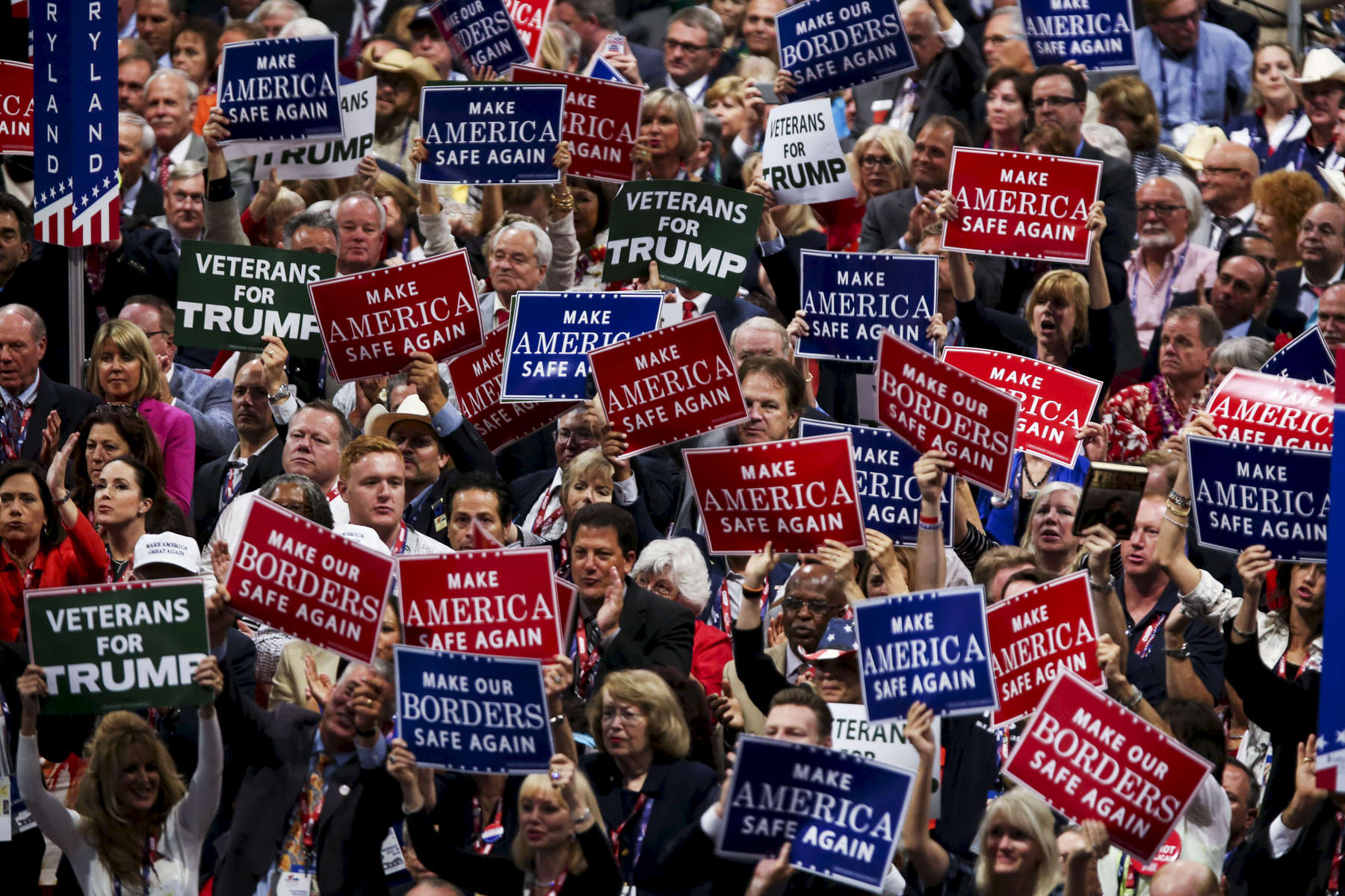 Republican delegates hold signs on the first day of the Republican convention in Cleveland, Ohio.