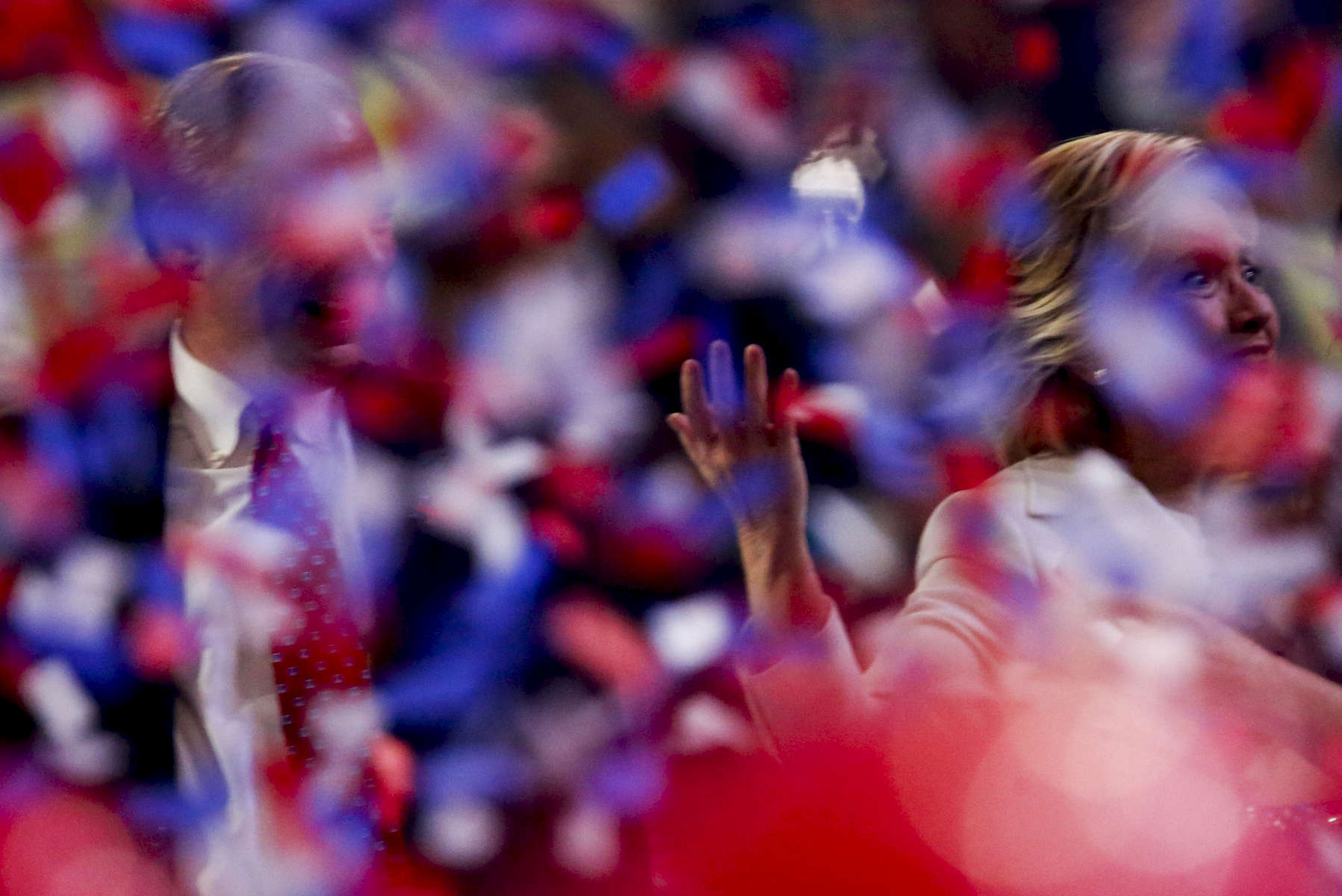 Democratic Presidential nominee Hillary Clinton with Democratic Vice Presidential candidate Tim Kaine wave under the confettis.
