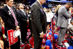 Republican delegates pray the end of the RNC.