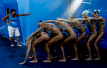 The Ukranian team practices its routine with their coach before competing in the Synchronised Swimming Team Free preliminaries, during the FINA World championships in Budapest, Hungary on July 19, 2017.