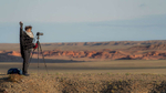 Doing photography at the Flaming Cliffs.  Photo Courtesy of  Mongolia Photo Tour