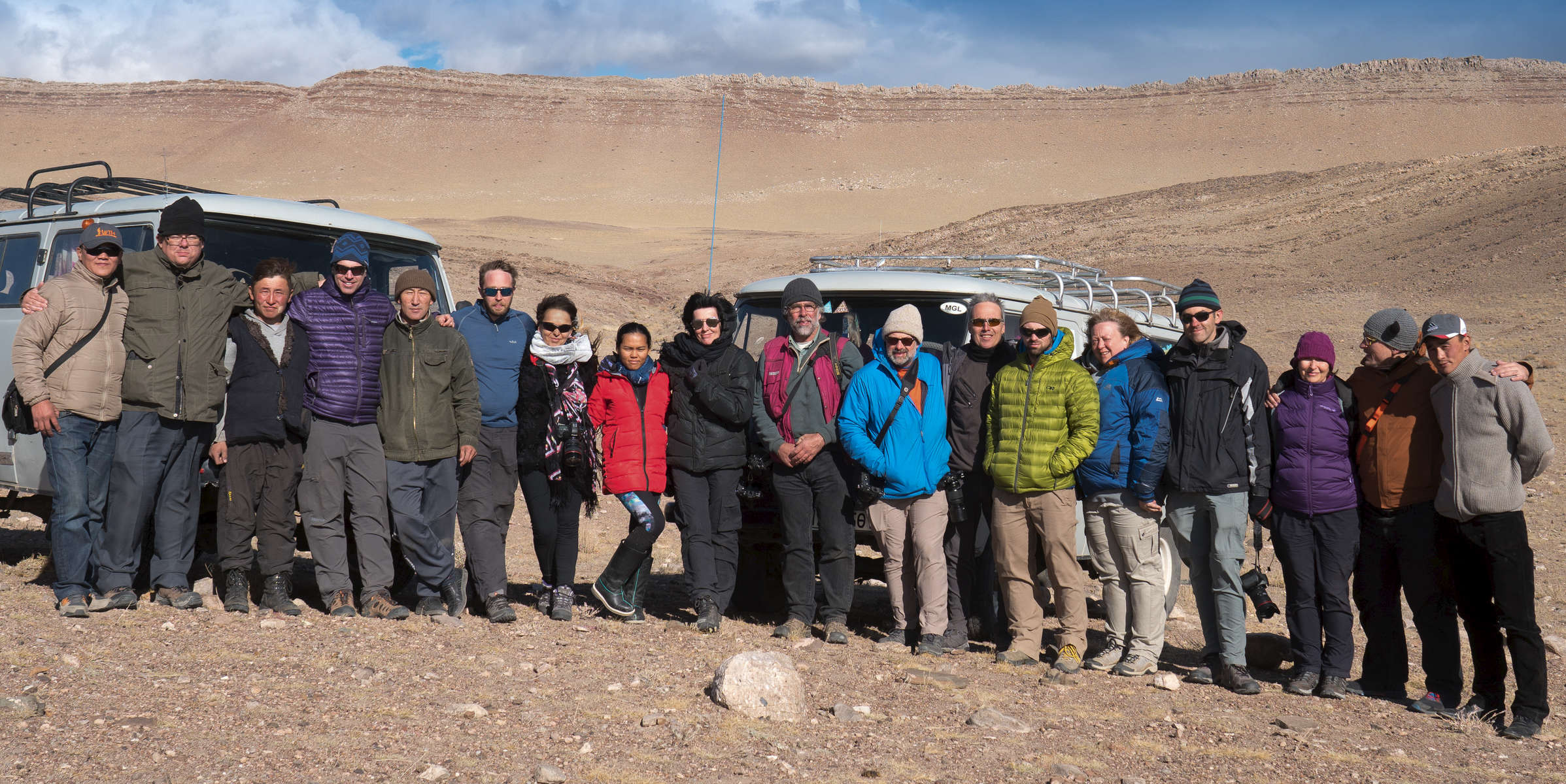 Group Photo on a windy day! in the Kazakh region of Mongolia.  Photo Courtesy of Mongolia Photo Tour